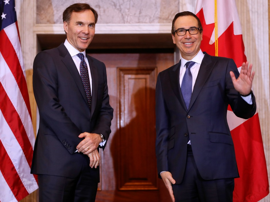 Treasury Secretary Steven T. Mnuchin, right, with Canadian Finance Minister William F. Morneau, left, before the start of their bilateral meeting at the U.S. Treasury Building in Washington, Wednesday, March 1, 2017. (AP Photo/Pablo Martinez Monsivais)