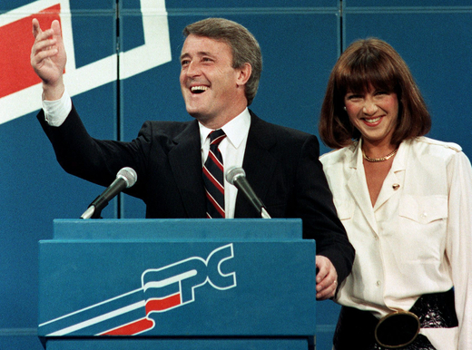 Brian Mulroney and Mila wave from the stage on election night Sept. 4, 1984. (CP PHOTO/stf)