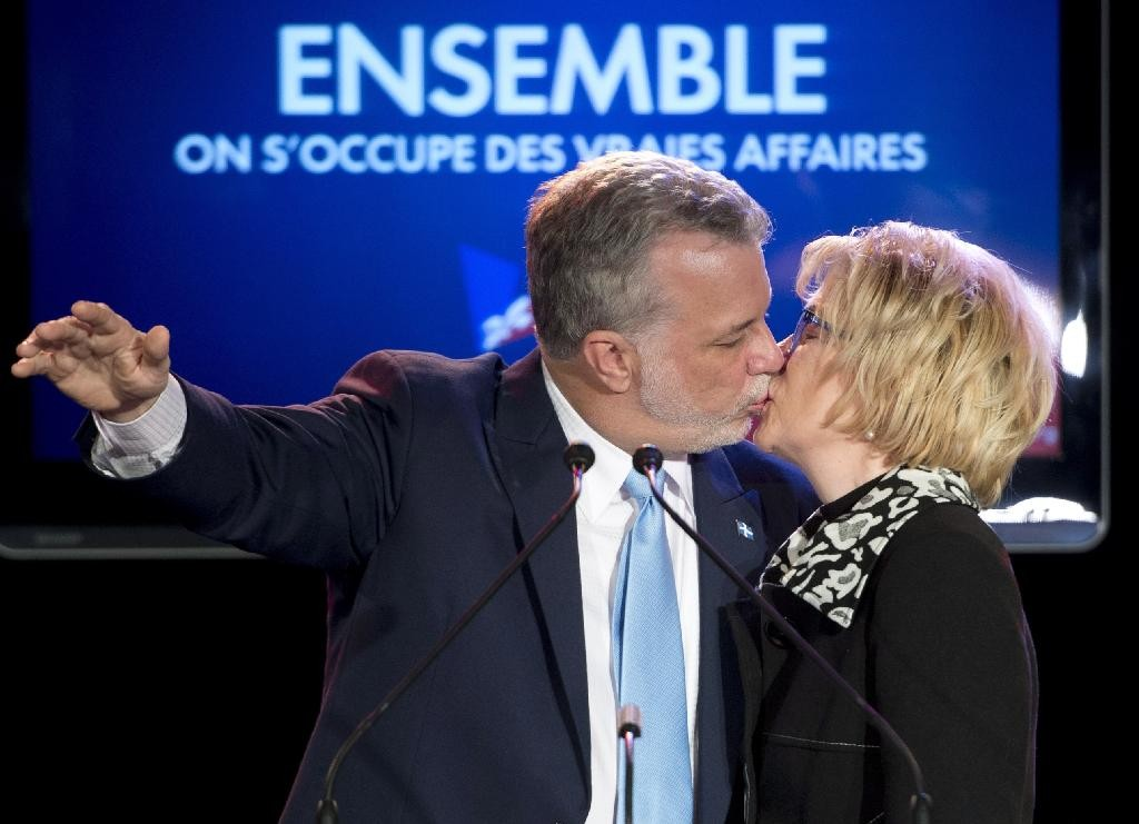 Quebec Liberal Leader Philippe Couillard, left, kisses his wife Suzanne Pilote after giving his victory speech, Monday, April 7, 2014 in St-Felicien Que. THE CANADIAN PRESS/Jacques Boissinot
