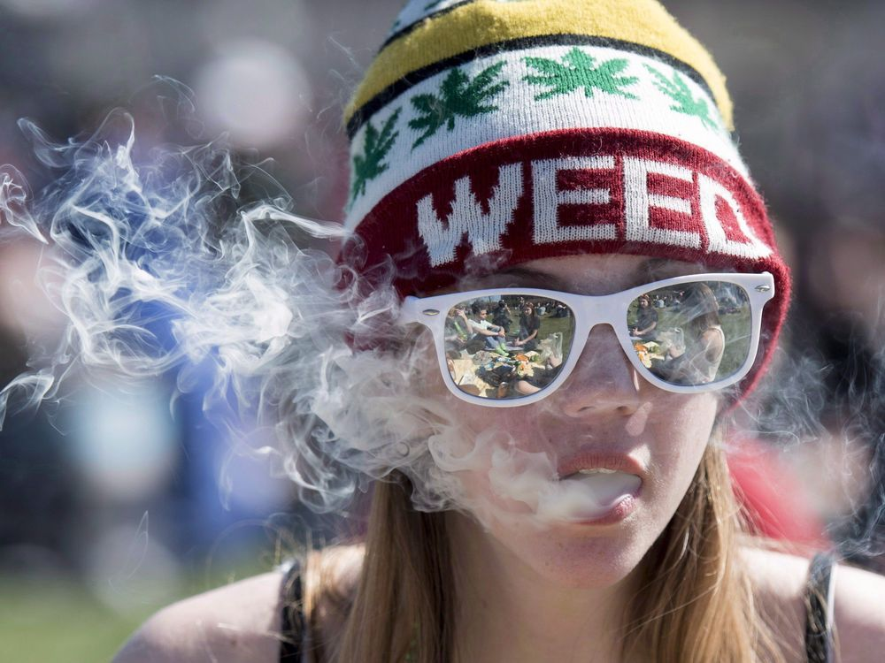 A woman exhales while smoking a joint during the annual 420 marijuana rally on Parliament Hill on Wednesday, April 20, 2016 in Ottawa. Ontario adolescents are drinking, smoking and using cannabis and other recreational drugs at the lowest rates since the late 1970s, suggests a biennial survey of Grade 7 to 12 students by the Centre for Addiction and Mental Health. THE CANADIAN PRESS/Justin Tang ORG XMIT: CPT139