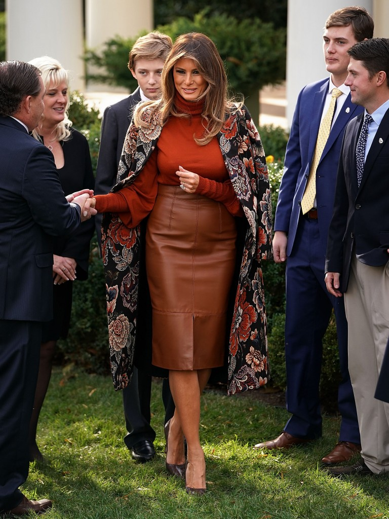 WASHINGTON, DC - NOVEMBER 21:  U.S. first lady Melania Trump waves goodbye as she and her son, Barron Trump leave following the pardoning ceremony of the National Thanksgiving Turkey in the Rose Garden at the White House November 21, 2017 in Washington, DC. Following the presidential pardon, the 40-pound White Holland breed which was raised by National Turkey Federation Chairman Carl Wittenburg in Minnesota, will then reside at his new home, 'Gobbler's Rest,' at Virginia Tech.  (Photo by Chip Somodevilla/Getty Images)