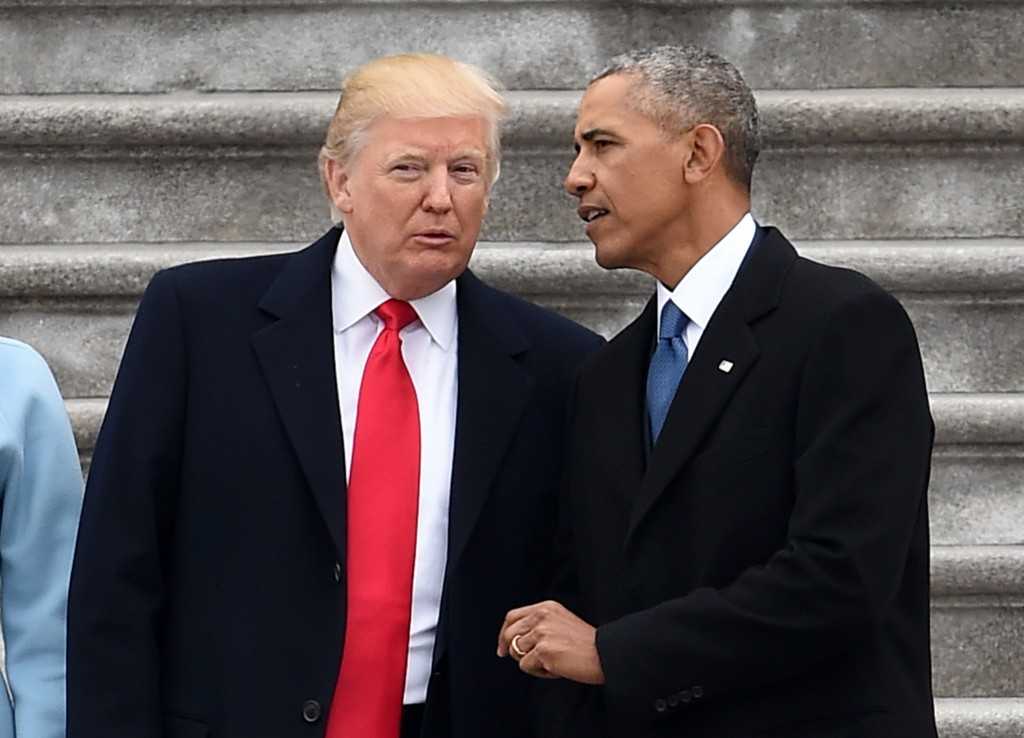President Donald Trump and former President Barack Obama talk on the East front steps of the US Capitol after inauguration ceremonies on January 20, 2017 in Washington, DC. / AFP / Robyn BECK        (Photo credit should read ROBYN BECK/AFP/Getty Images)
