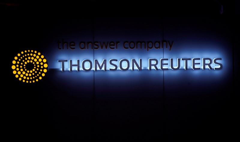 FILE PHOTO - A Thomson Reuters logo is pictured on a building during the World Economic Forum (WEF) annual meeting in Davos, Switzerland January 25, 2018. Picture taken January 25, 2018.  REUTERS/Denis Balibouse