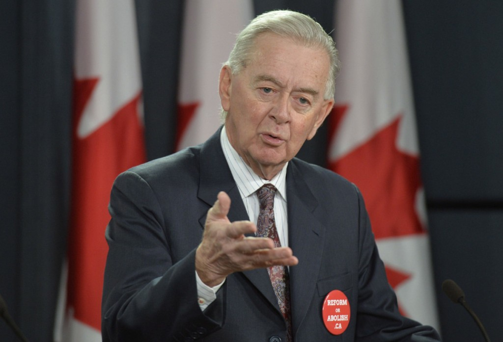 Preston Manning, former Leader of the Reform Party and CEO of the Manning Foundation Preston Manning speaks during a news conference Wednesday January 22, 2014 in Ottawa. THE CANADIAN PRESS/Adrian Wyld